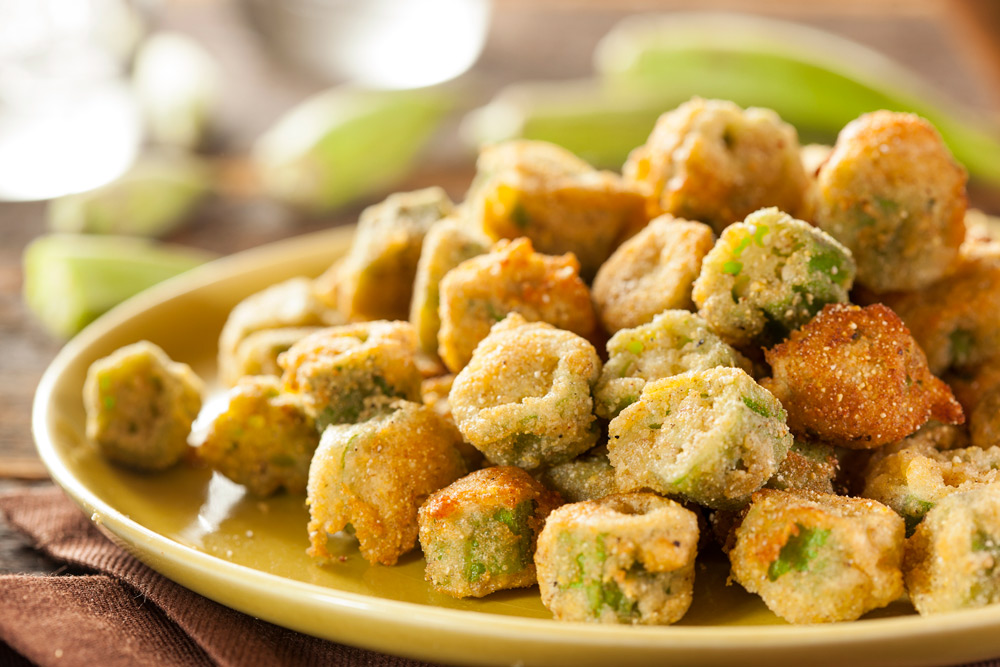 sliced okra breaded and cooked on a light colored plate